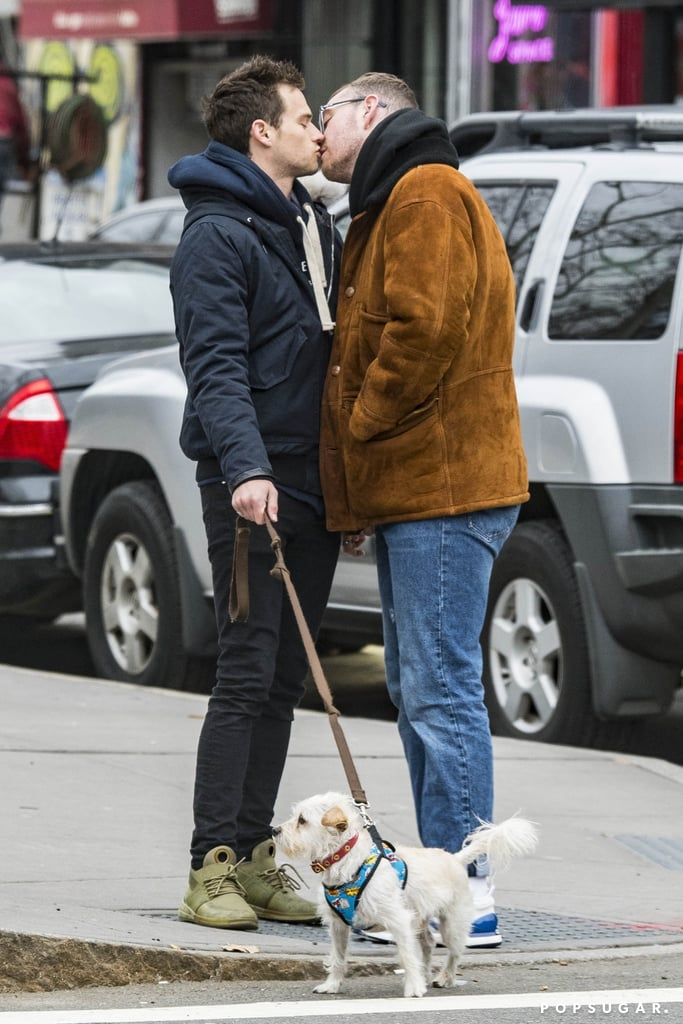 Sam Smith and Brandon Flynn appear to be on cloud nine ever since confirming their romance late last year. Following their Grammys date night, the couple was spotted packing on the PDA while walking Brandon's dog, Charlie, in NYC on Monday. In addition to holding hands and exchanging a few loving glances, Sam and the 13 Reasons Why actor stopped to share a few kisses on the street. Sam and Brandon first ignited romance rumors when they were spotted making out in the Big Apple back in October 2017, and shortly after, Sam confirmed he was officially off the market during a stop on The Ellen DeGeneres Show. Can you imagine if Sam made a surprise appearance on season two of 13 Reasons Why? We could only dream.