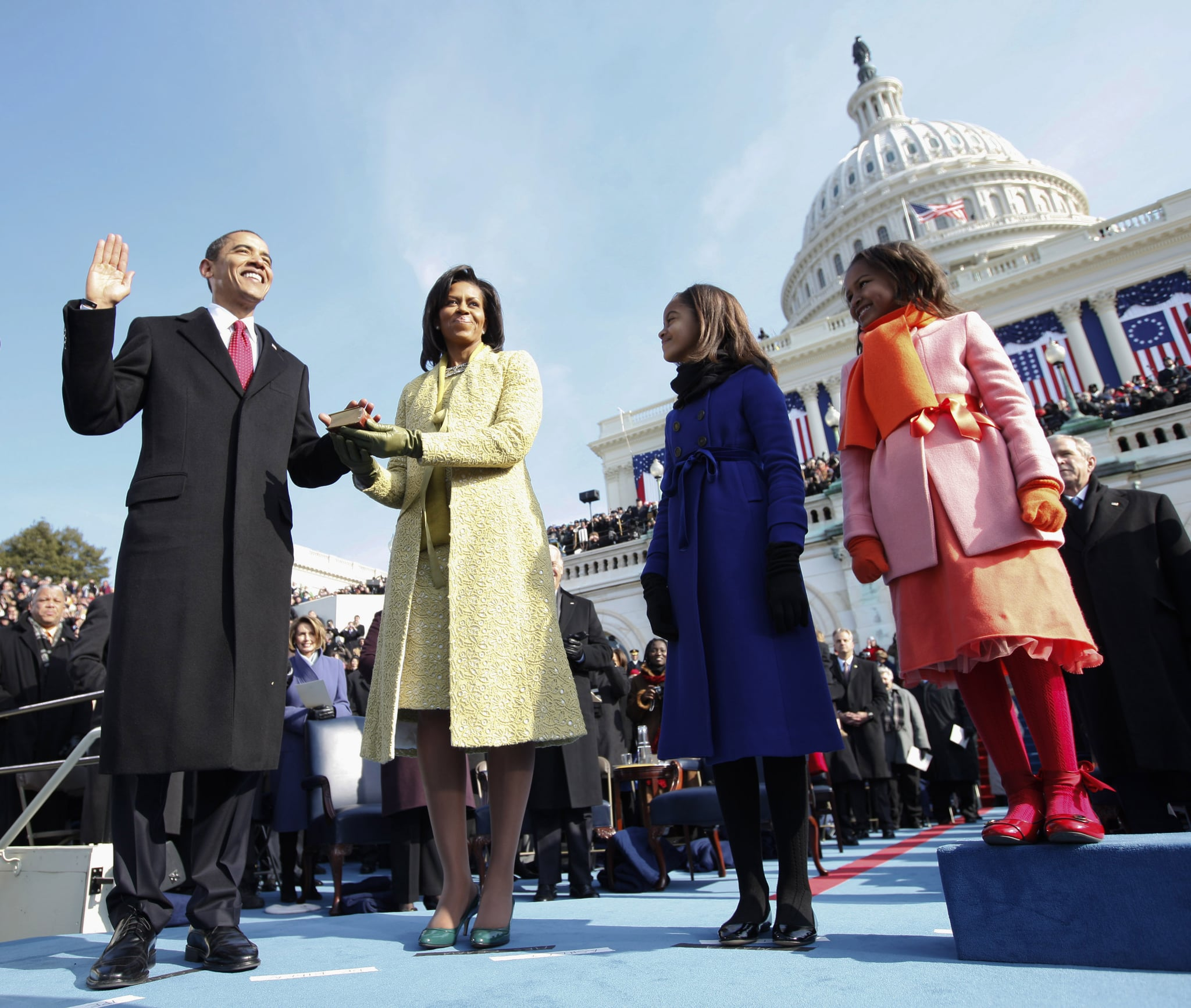 Barack Obama (L) takes the oath of office as the 44th US President with his wife, Michelle, by his side at the US Capitol in Washington, DC, January 20, 2009. The Obama's were joined by their daughters Malia (2ndR) and Sasha. Chuck Kennedy/Pool (Photo credit should read CHUCK KENNEDY/AFP via Getty Images)