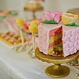 The pink and lemon-yellow cake revealed that the guest of honor is having a girl.