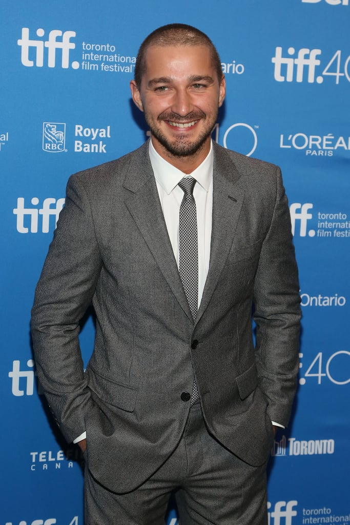 Shia LaBeouf was a sight for sore eyes as he arrived for the press conference of his new film, Man Down, at the Toronto International Film Festival on Tuesday. The actor wore a sleek grey suit and showed off his newly shorn hair while posing for photos with his co-star Kate Mara; the two got sweet and silly on the red carpet, and Shia was all smiles while answering questions during his interviews. It's been a rough couple of years for the actor, but if his recent outings in Toronto and at the Venice Film Festival are any indication, Shia could be on an upswing. Dare we say it, or is Shia bringing us back to his super-hot Transformers days with his new look? Keep reading to see 24 photos of Shia looking happier and hotter than ever, then look back on his sexiest moments over the years.