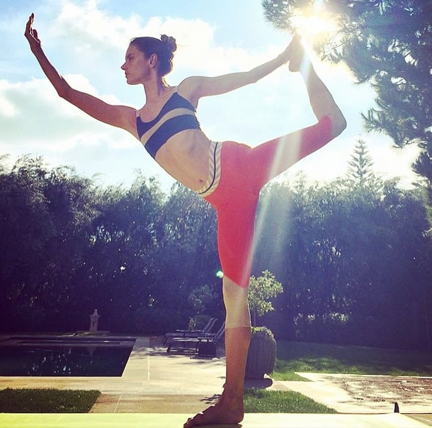 Alessandra Ambrosio knows that yoga is a great way to warm up in the morning and keep in lingerie-model shape.
