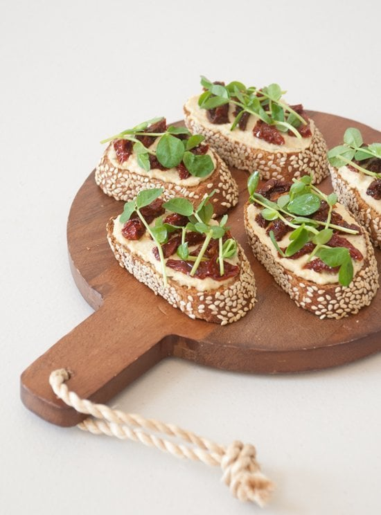 Appetizer: Hummus, Sun-Dried Tomato, and Pea Shoot Crostinis