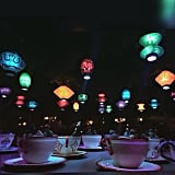 The colourful lanterns that hang above the teacups.