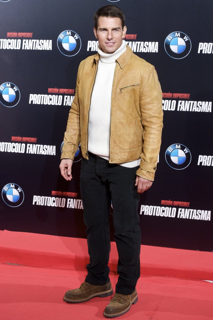 Tom Cruise arrived at the Madrid premiere in a turtleneck and camel colored jacket.