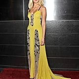 Erin Heatherton opted for a yellow printed maxi gown with a modern printed inset detailing.