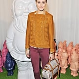 We love Olivia as much for her high-fashion ensembles as we do for her accessible combos, like this one that she showed off at Mulberry's Spring show in London. She paired a BB Dakota sweater with skinny Current/Elliott jeans, then upped the ante on the look with a printed Mulberry satchel.