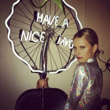 Karolína Kurková struck a pose near a neon sign.  Source: Twitter user karolinakurkova