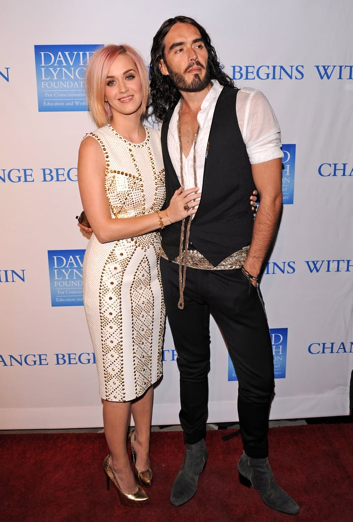 Katy Perry joined hubby Russell Brand and wore a stud-embellished white Versace sheath at the third annual Change Begins Within benefit in LA.