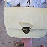 We love the pale yellow tint on this Topshop bag. The crossbody style is perfect for hands-free action.