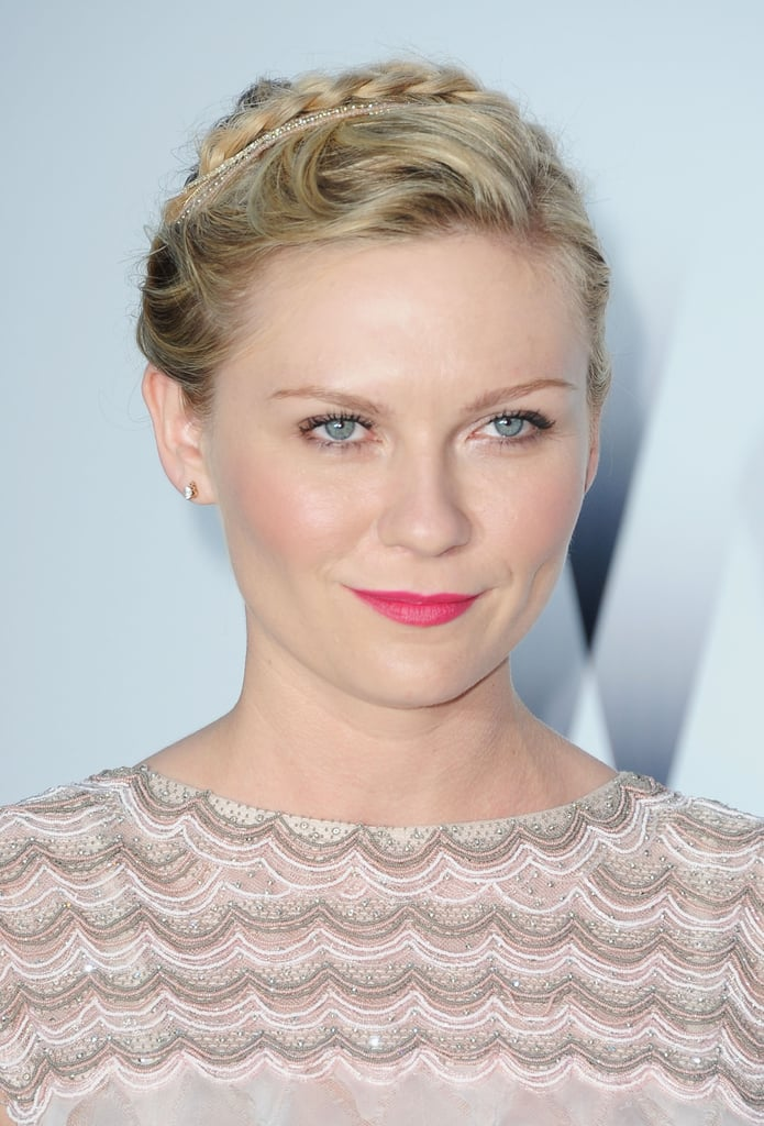 Braids have become part of Kirsten's signature, and this demure braid looked darling paired with a hot-pink lip in 2011.