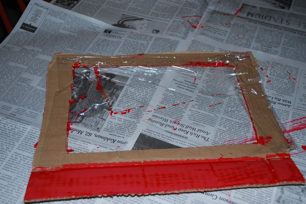 "Paint the ""windshield"" the same color as the racing stripes and attach a piece of plastic wrap to the inside of the boarder."