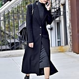 The great thing about long coats is you can wear them over your Summer dresses, meaning you don't have to put away those pieces just yet.
