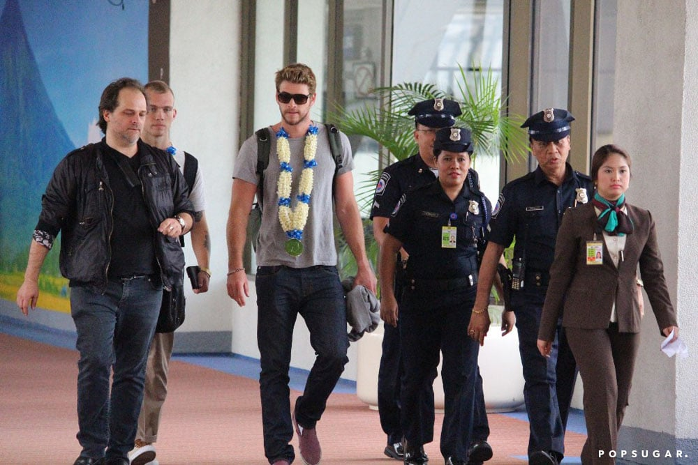 Liam Hemsworth was escorted out of the airport by police.