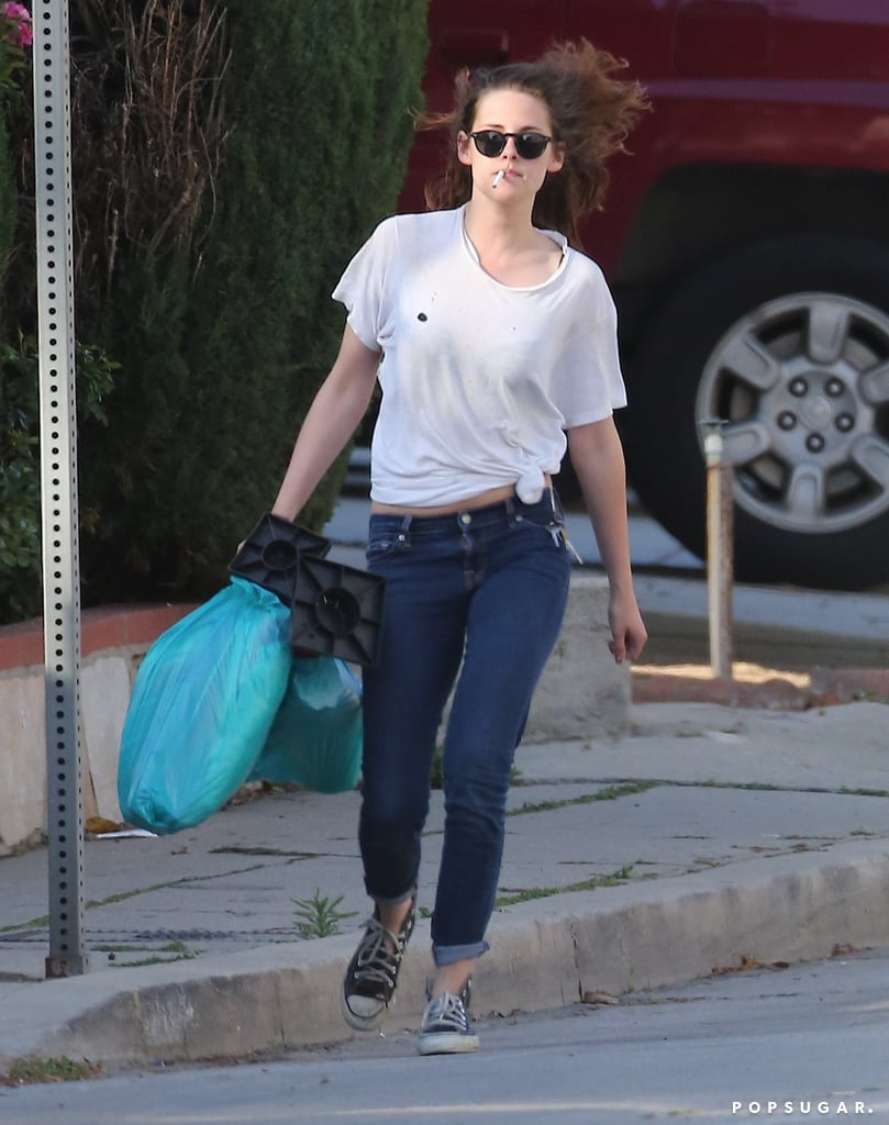 Kristen Stewart made a solo errand run around Los Feliz yesterday looking casual in a tied t-shirt and jeans. She's back in LA after spending the weekend in Indio, CA, at the Coachella Valley Music and Arts Festival with Robert Pattinson. The couple were just a few of the many stars at Coachella, and the fun isn't over yet, since weekend two kicks off on Friday. Kristen has been spending downtime with Rob since his return from Australia last month, but she's also been busy lining up new projects. It was confirmed yesterday at CinemaCon in Las Vegas that Kristen will star in the Snow White and the Huntsman sequel, which is due out in 2015. Her involvement with the franchise came into question last Summer, when she and the first film's director, Rupert Sanders, were caught cheating. The director for the second installment has yet to be announced.  Source: X17Online
