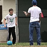 David Beckham and Brooklyn Beckham passed the ball back and forth.