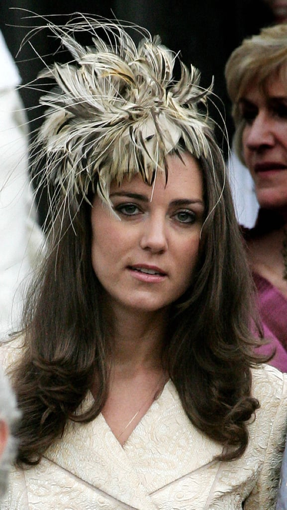 Kate favored a similar palette for her Day Birger et Mikkelsen coat and feathery fascinator at the wedding of Laura Parker-Bowles in 2006.