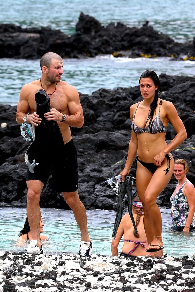 """If you thought Sam Hunt was hot before, prepare for these photos to send your heart into overdrive. The """"Take Your Time"""" singer was photographed enjoying a snorkeling session with rumored girlfriend Hannah Lee Fowler in Kona, HI, on Thursday, where he flaunted some pretty eye-catching biceps and a much shorter 'do. At the CMT Music Awards in June, Sam revealed that he no longer wanted to be single, and although he was linked to actress Kaley Cuoco earlier this year, it appears things are going swimmingly (literally) for him and Hannah."""