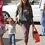 During a day out with her family, Jessica Alba got creative by matching her olive blouse with mauve khakis and nude sunglasses.