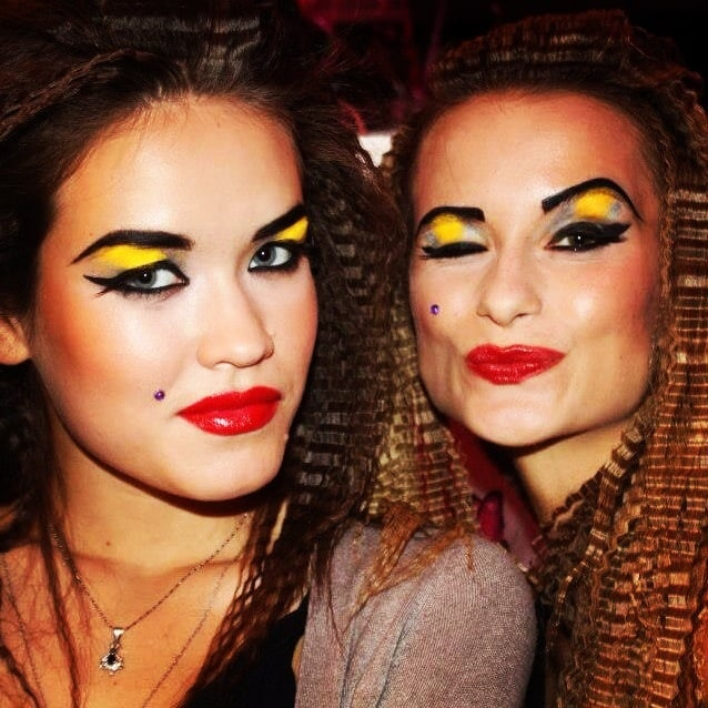 Diamond beauty marks, glitter lips, and crimped hair were all part of the models' beauty looks at Betsey Johnson.