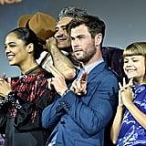 Pictured: Tessa Thompson, Chris Hemsworth, and Lia McHugh at San Diego Comic-Con.