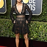 She isn't afraid to rock a sheer minidress on a red carpet. She rocked this lacy bell-sleeved cocktail dress from Zuhair Murad at the 2018 Golden Globe Awards.