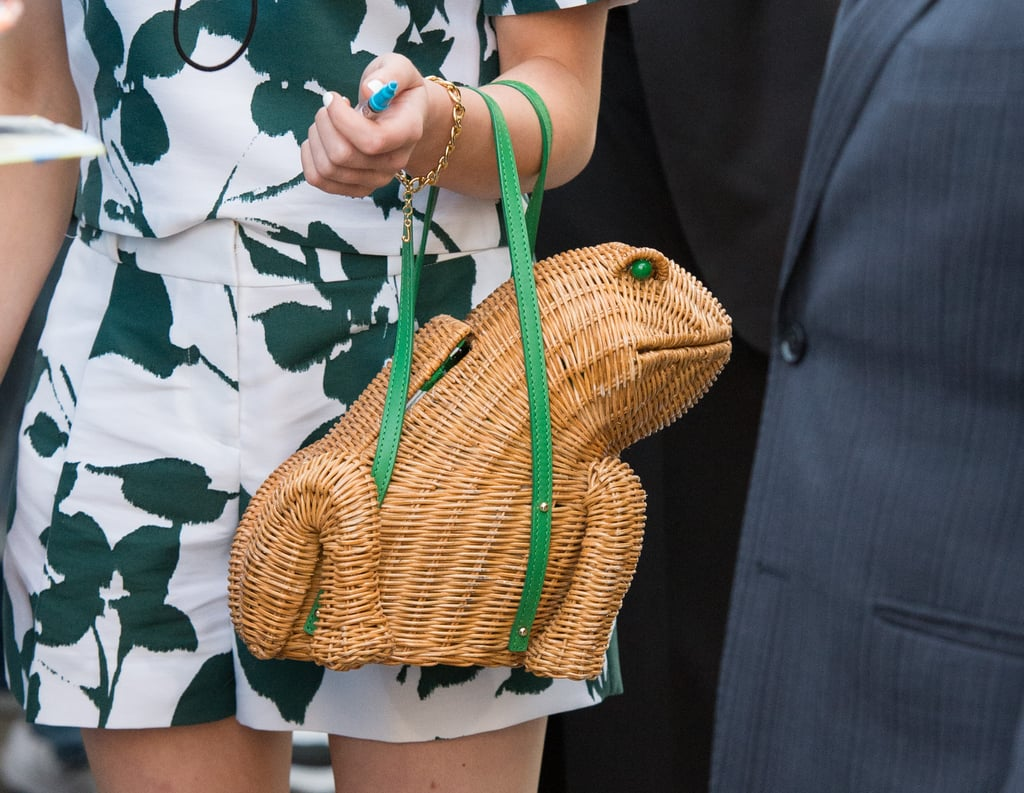 She paired her look with the sweetest wicker frog bag ($398), also from Kate Spade.
