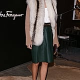 Olivia added her luxe vest to a forest-green skirt for a perfect holiday outfit.