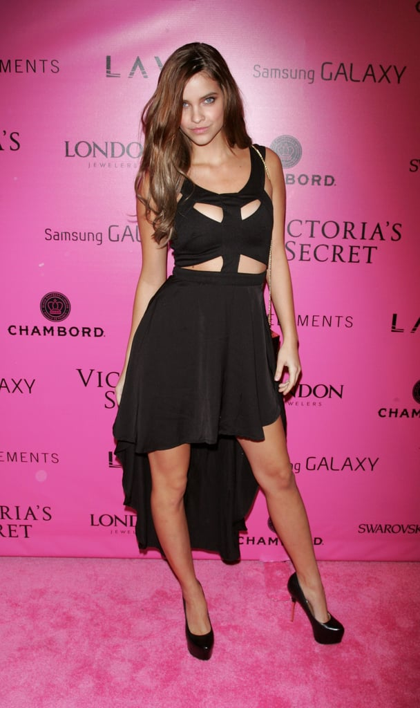 Barbara Palvin chose a cutout black dress with a dramatic high-low hem.