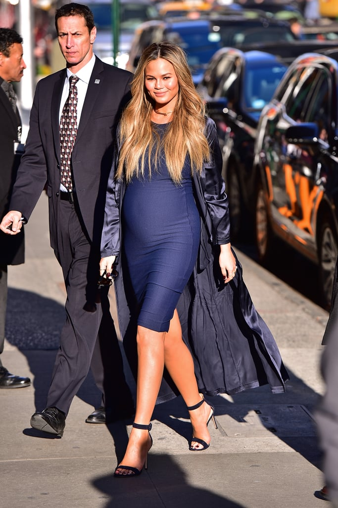 For an appearance on Good Morning America, Chrissy wore a body-con navy-blue dress with a silk robe on top. She accessorized with ankle-strap sandals and a gold Jennifer Fisher choker necklace.
