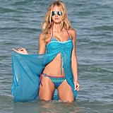 Erin Heatherton posed with a blue sarong with her bikini.