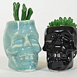 These ceramic planters ($16 each) come in either light blue or black.