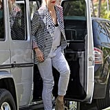 Gwen Stefani looked great as she sported a black and white checked blazer with white pinstriped pants and wedges.