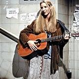 Phoebe Skillfully Layers a Fringe Jacket Over Her Denim Coat