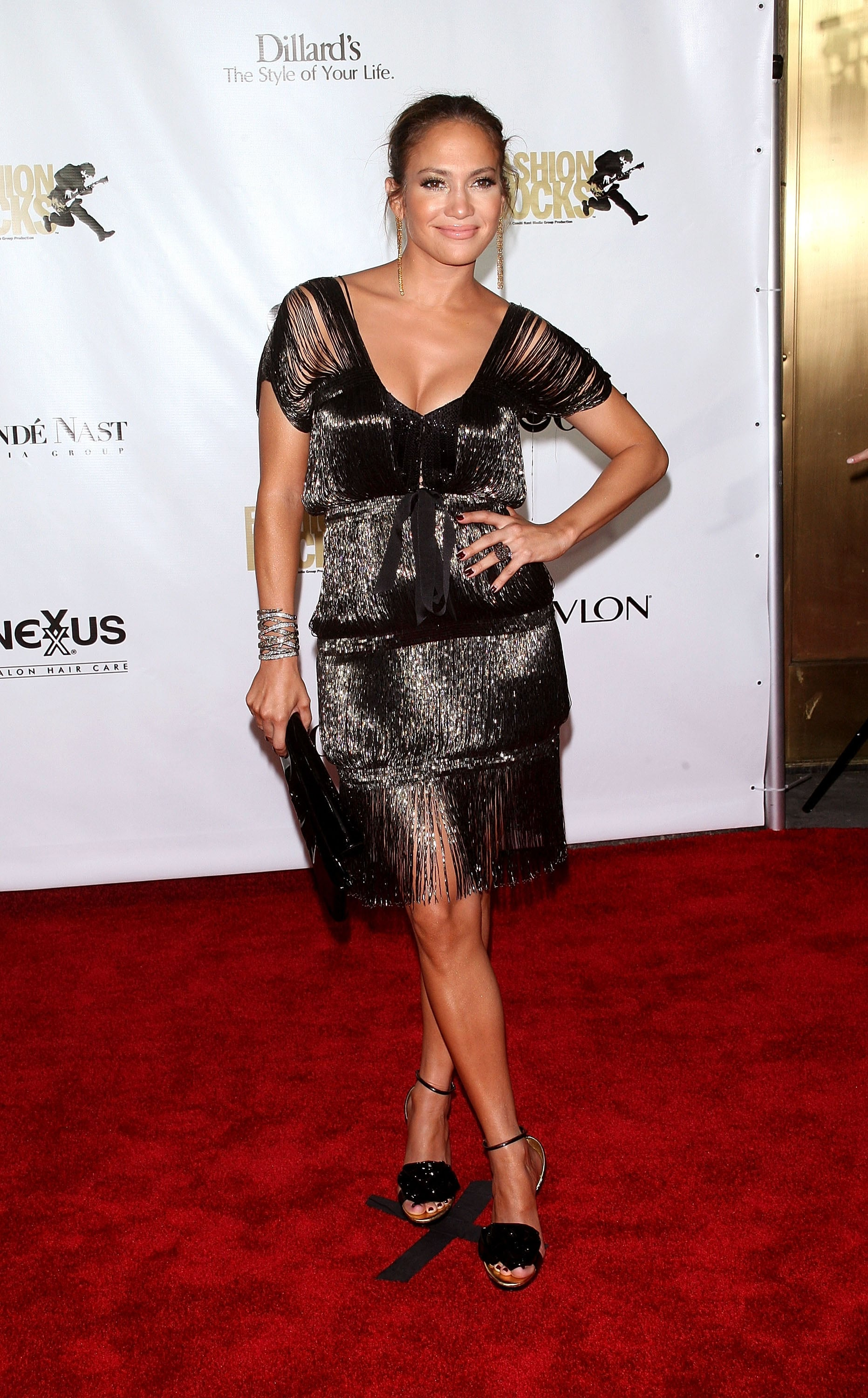 Opting for a looser silhouette in this shimmery, black sheath in 2007.
