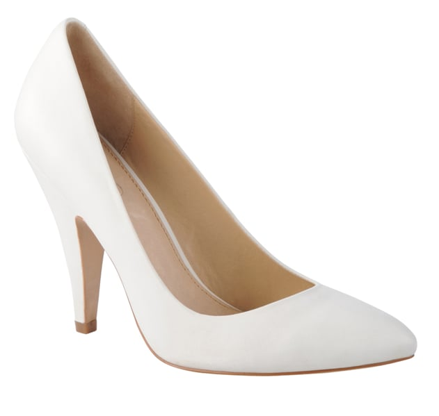 Pair a classic, low-heeled white pump with a tea-length dress for an altogether retro feel. While the closed toe look is fair game in the colder months, this style totally goes with shorter dress lengths year-round. Aldo Loudermill Pumps ($90)