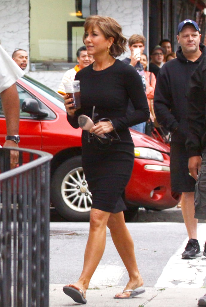 On July 25, Jennifer Aniston carried her heels while walking in more feet-friendly flip-flops.