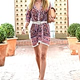 Rosie Huntington-Whiteley strutted out of a hair salon in LA wearing a paisley-print minidress with neutral add-ons: a white belt, nude ankle-strap sandals, a tan crocodile clutch, and aviator sunglasses.
