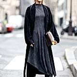 Leigh Lezark worked a minimalist look in an asymmetrical dress and long coat, which only further spotlighted her accessories.
