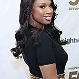 To get classic curls like Jennifer Hudson, use a one-and-one-fourth-inch curling iron on freshly blown-out hair. Use hair spray and shine serum to get a polished look.