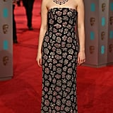 At the 2016 British Academy Awards wearing a strapless Burberry gown that featured sparkly flowers. She finished off her look with Giuseppe Zanotti shoes and Chopard jewels.