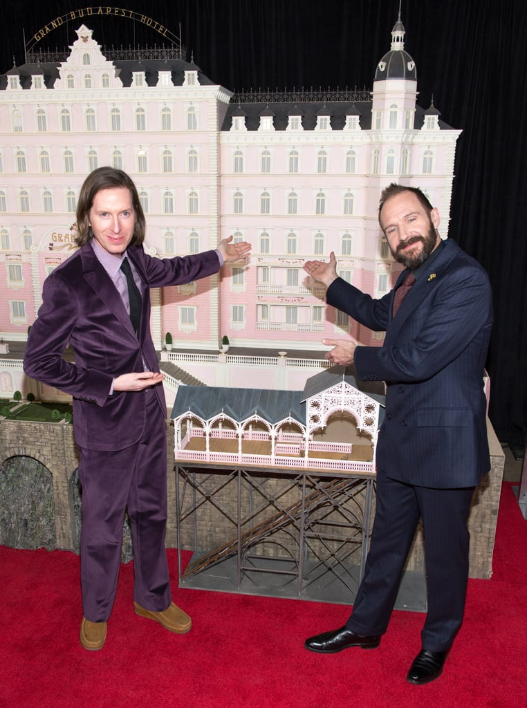 Wes Anderson and Ralph Fiennes posed in front of the miniature from their new film, The Grant Budapest Hotel, in NYC on Wednesday.