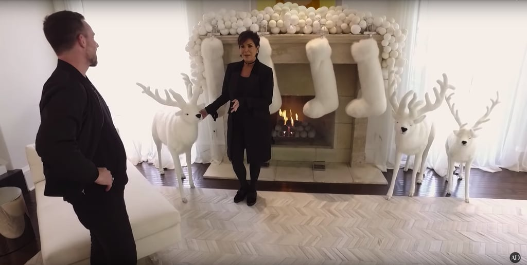 The fireplace was decked out in white in 2016, including the snow-like garland and animatronic reindeer.