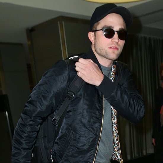 Robert Pattinson Carrying Guitar at JFK Pictures