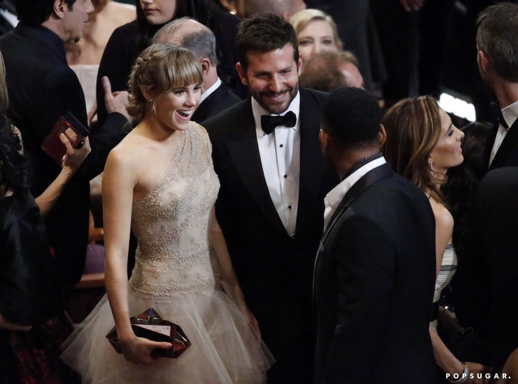 Bradley Cooper looked superhot at the Oscars — but then again, what else is new? The nominated actor arrived in a handsome black tux and bow tie, and flashed his pearly whites for everyone gathered on the red carpet. Later, the actor took center stage as one of the night's presenters. He also showed PDA with his girlfriend, Suki Waterhouse, inside the ceremony. Bradley had some stiff competition during the ceremony, as he went up against Jared Leto for best supporting actor. Jared, who has been sweeping the category this award season, ultimately won. Keep reading to see the adorable photos of Bradley, and be sure to vote for your favorite red carpet looks tonight in our fashion and beauty polls!