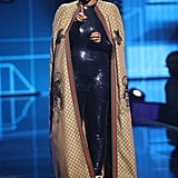 Tracee took the stage in a glittery black catsuit, capped off with a full-length Gucci coat.