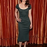 Emilia Clarke looked sophisticated in a dark green formfitting dress and black pumps at the Breakfast at Tiffany's press preview in NYC.
