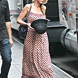Blake Lively wore yet another Serena van der Woodsen-approved printed maxi dress on set — we're digging the laid-back accents here, too. A cloche hat and slouchy Chanel bag completed the season-six outfit.