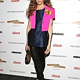 Sarah Jessica Parker melded navy and black with leather leggings and a structured navy top, then added a pop of flair via a bright pink Jil Sander jacket in April 2008.
