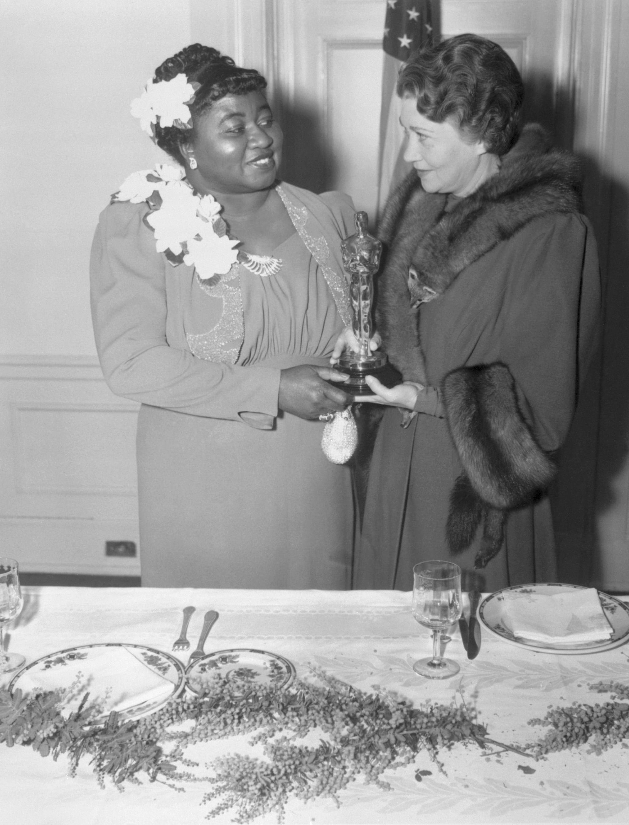 (Original Caption) Twelfth Annual Banquet of the Academy of Motion Picture Arts and Sciences. Los Angeles, California: Actress Fay Bainter (right) presenting Hattie McDaniel (left) her award for her supporting role in Gone With the Wind. February 29, 1940.