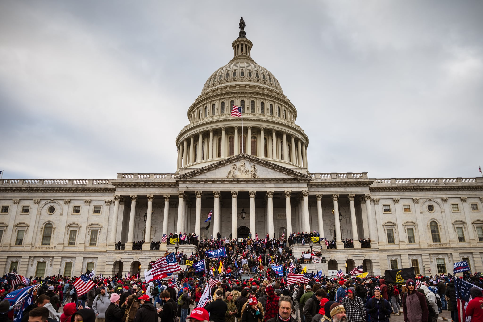 WASHINGTON, DC - JANUARY 06: A large group of pro-Trump protesters stand on the East steps of the Capitol Building after storming its grounds on January 6, 2021 in Washington, DC. A pro-Trump mob stormed the Capitol, breaking windows and clashing with police officers. Trump supporters gathered in the nation's capital today to protest the ratification of President-elect Joe Biden's Electoral College victory over President Trump in the 2020 election. (Photo by Jon Cherry/Getty Images)